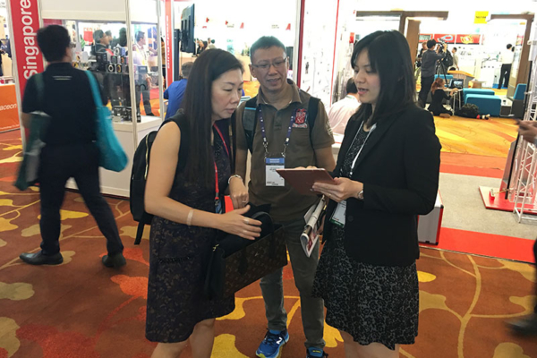 Juan attending to visitors at CommunicAsia 2017