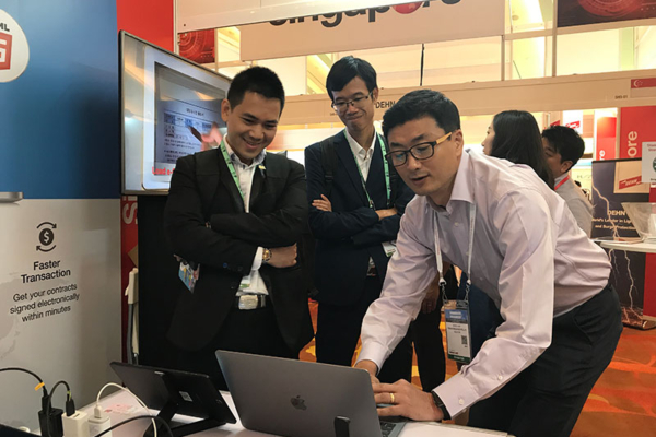 MIckey, showcasing Smart e-Form at CommunicAsia 2017