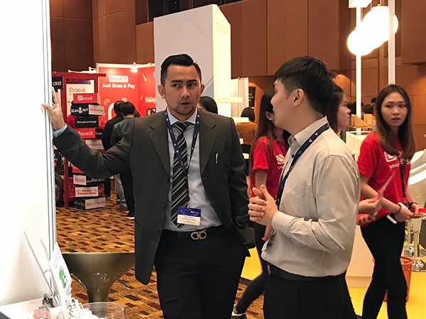 Visitor at FORCS booth, Malaysia FinTech Expo 2018
