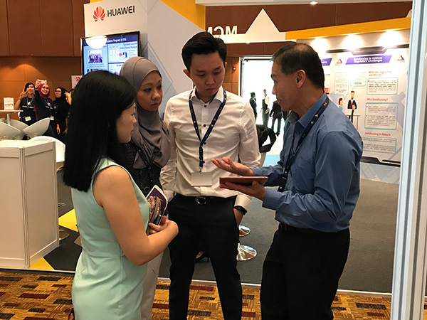 Showcasing OZ e-Form demo at Malaysia FinTech Expo 2018