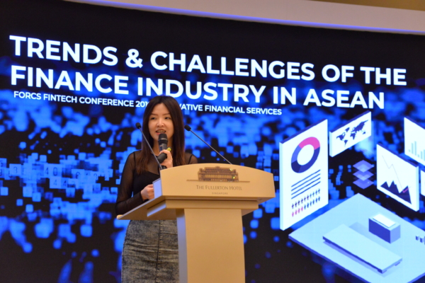 Daphne Ng, CEO of JEDTrade, presenting on stage