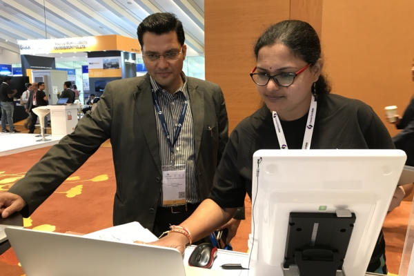Shravani, Software Engineer, presenting to customer at FORCS booth