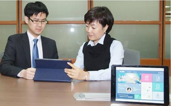 KEB Hana Bank banker and customer using the new banking system